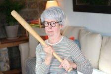 senior woman security baseball bat
