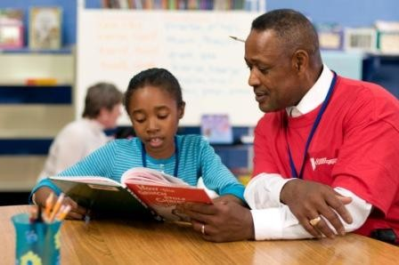Foster grandparent reading with child