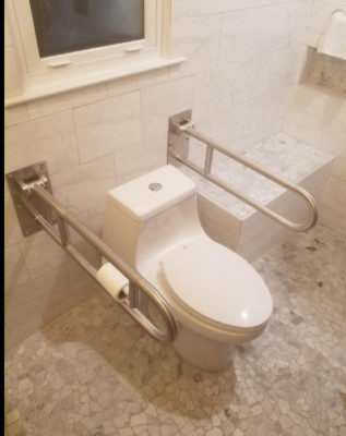 Double toilet grab bars for lifting yourself up.