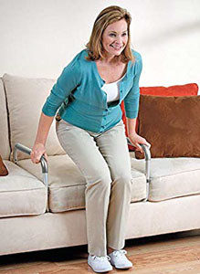 The Stand Roo Stand Aid inserts under the couch cushion. Push on the bars to gain leverage when standing or sitting.