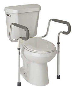 This toilet assistance device surrounds the toilet and has two rubber feet on the floor.