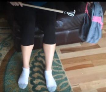 2. Loop the hook through a pants leg hole.