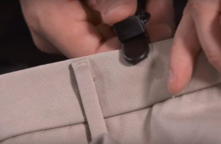 2. Attach the clips to the sides of the pants opening.
