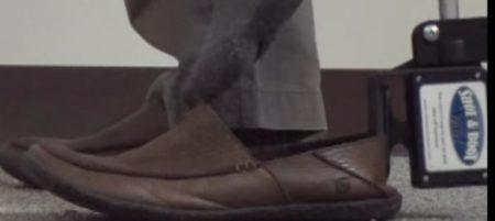 2. Squeeze the grabber onto the shoe back.