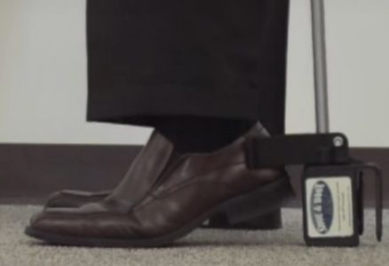 3. With the bottom box on the floor, lift your heel so that the shoe heel rises into the U-hook.