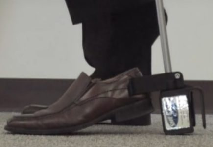 4. Use the U-Hook to hold the shoe in place as you lift your foot out of the shoe.