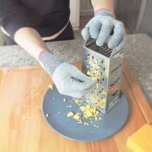 Cutting gloves protect hands while grating