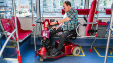 Scooter user locking into bus seat area