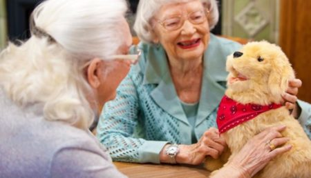 Elderly women enjoying the robot dog