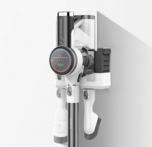 The Tineco hanging from the cradle-recharger. There's room for the battery in the machine and the extra battery, both are charging.