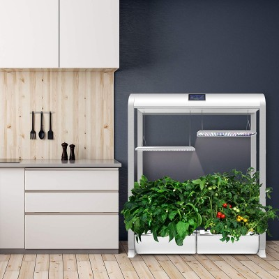 The AeroGarden Farm XL is wider than an average kitchen cabinet and sits on the floor