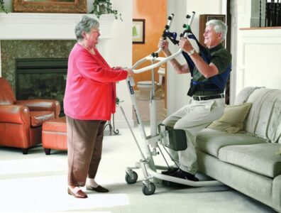 For help standing, this transport includes straps for more patient support.