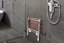 JC Wang Teak Bath Chair on shower wall