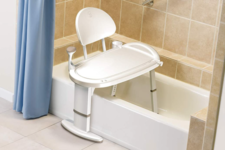 Moen Home Care Safety Transfer Bench sits over the bathtub wall